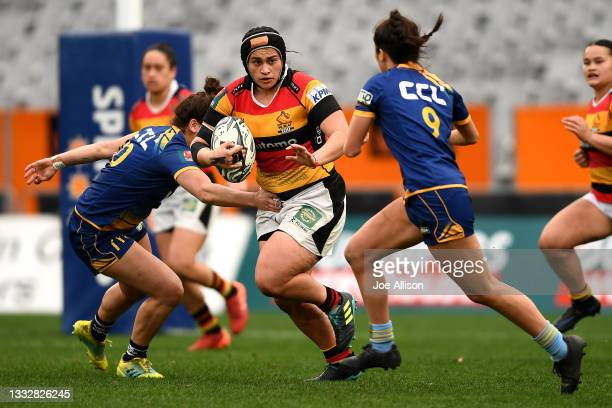 Grace Houpapa-Barrett of Waikato runs into the defence during the round four Farah Palmer Cup match between Otago and Waikato at Forsyth Barr...