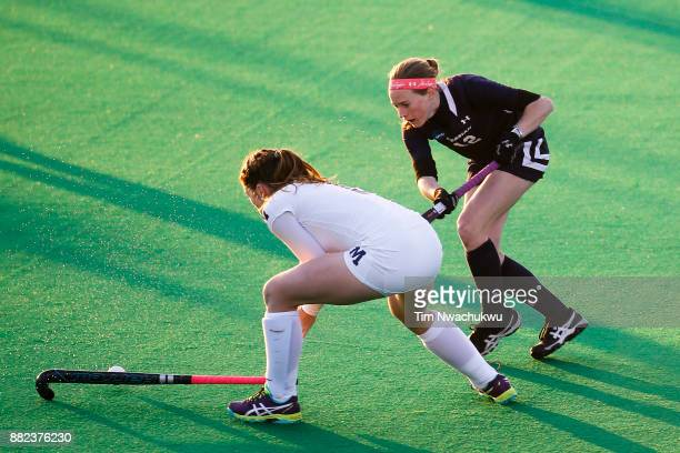 Grace Jennings of Middlebury College blocks a pass by Kristin Donohue of Messiah College during the Division III Women's Field Hockey Championship...