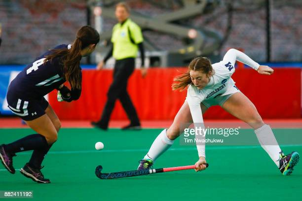Grace Jennings of Middlebury College tries to block a pass by Kaylor Rosenberry of Messiah College during the Division III Women's Field Hockey...