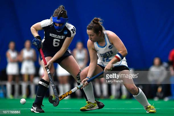 Grace Jennings of the Middlebury Panthers and Rachel Hamilton of the Tufts Jumbos compete for the ball during the Division III Women's Field Hockey...