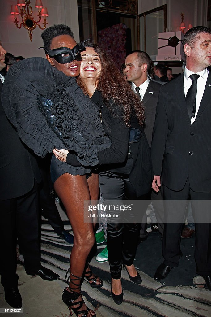 Grace Jones and Afef Jnifen attend the Victor & Rolf 'Flower Bomb' 5th Anniversary Party at Hotel Meurice on March 4, 2010 in Paris, France.