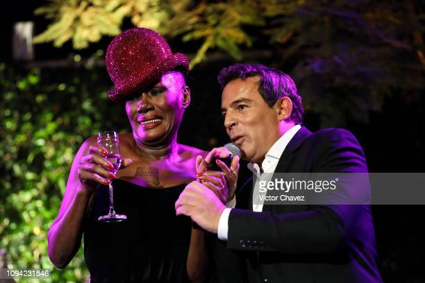 Grace Jones and Eugenio Lopez talk to the guests during the amfAR gala dinner at the house of collector and museum patron Eugenio López on February 5...
