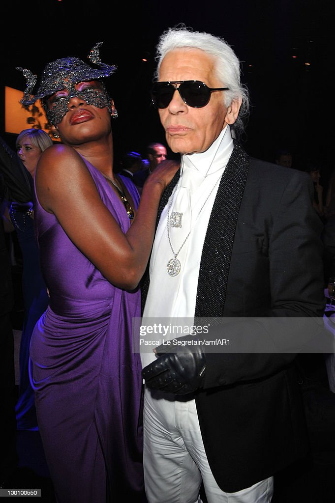 Grace Jones and Karl Lagerfeld attend amfAR's Cinema Against AIDS 2010 benefit gala dinner at the Hotel du Cap on May 20, 2010 in Antibes, France.