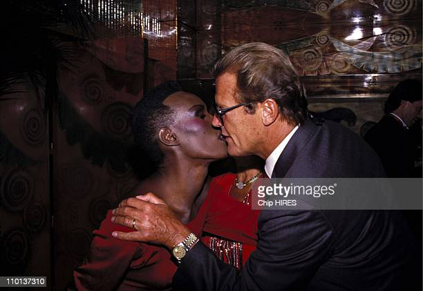 Grace Jones and Roger Moore at the premiere of 'Dangereusement votre' in ParisFrance on September 10th1985
