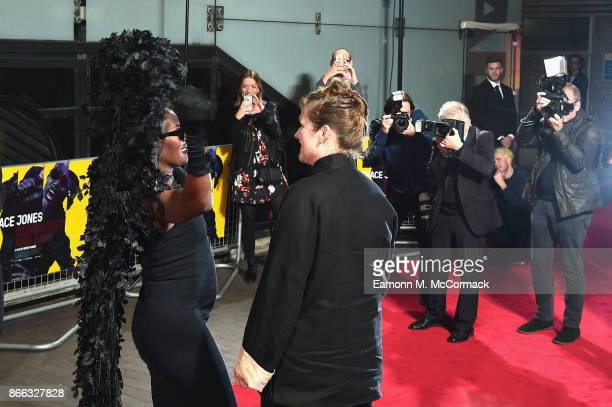 Grace Jones and Sophie Fiennes pose for photographers at the 'Grace Jones Bloodlight And Bami' UK premiere at BFI Southbank on October 25 2017 in...