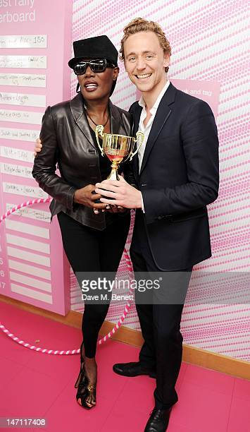 Grace Jones and Tom Hiddleston attend the evian 'Live young' VIP Suite at Wimbledon on June 25, 2012 in London, England.