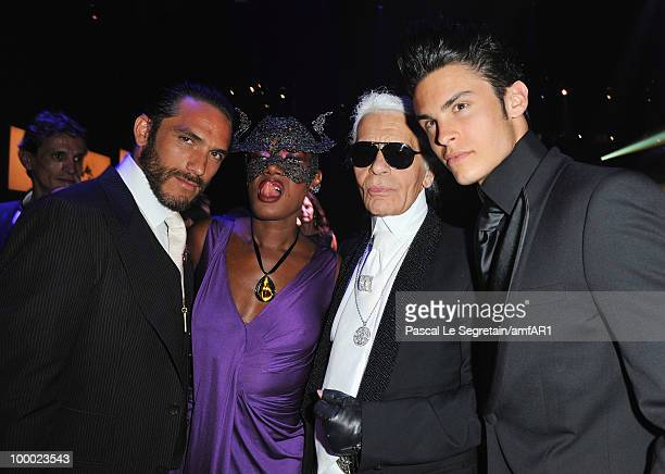 Grace Jones Karl Lagerfeld and Baptiste Giabiconi attend amfAR's Cinema Against AIDS 2010 benefit gala dinner at the Hotel du Cap on May 20 2010 in...