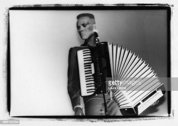 Grace Jones performing with an accordion