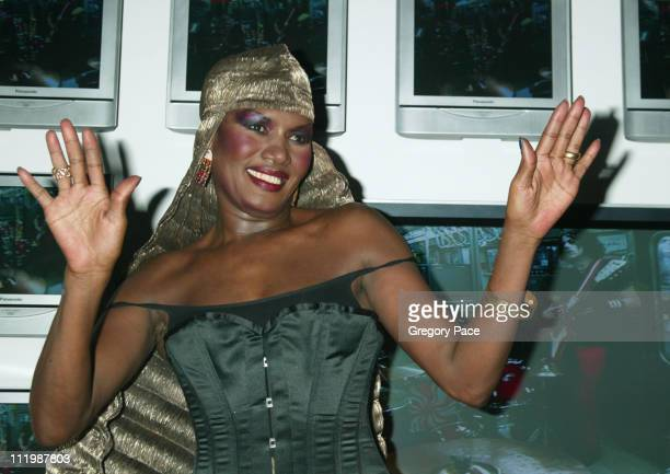 Grace Jones wearing an outfit designed by Issey Miyake