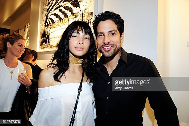 Grace Kale and Adam Rodriguez attend the 'Tom Everhart 'Raw' Exhibition of His Schulzinfluenced Paintings For The First Time In Black And White At...