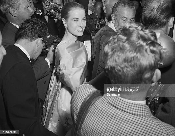 Grace Kelly Arrives For Academy Awards. Hollywood: Actress Grace Kelly smiles brightly as she arrives for the 28th Annual Academy Award presentations...
