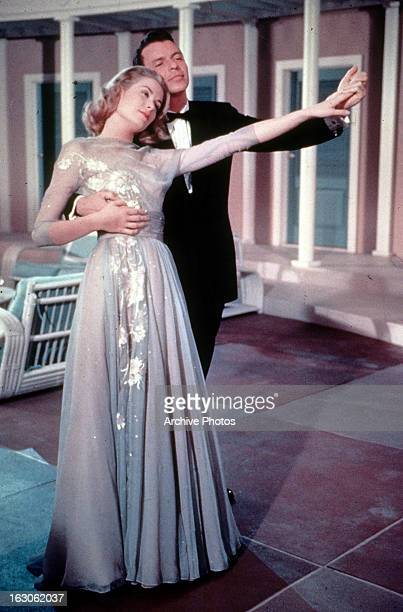 Grace Kelly dances with Frank Sinatra in a scene from the film 'High Society', 1956.