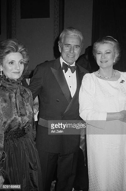 Grace Kelly John Forsyth and his wife Julie Warren Wagner attending a formal event circa 1970 New York