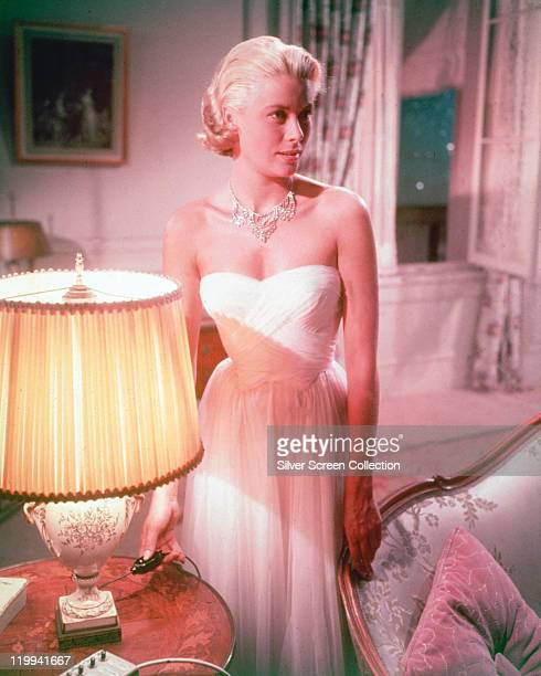 Grace Kelly US actress wearing a white strapless dress in a publicity still issued for the film 'To Catch a Thief' 1955 The romantic thriller...