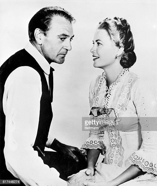"Grace Kelly's love-making in ""High Noon"" consisted of holding hands with and making eyes at shootin' sheriff Gary Cooper. 1952 film."