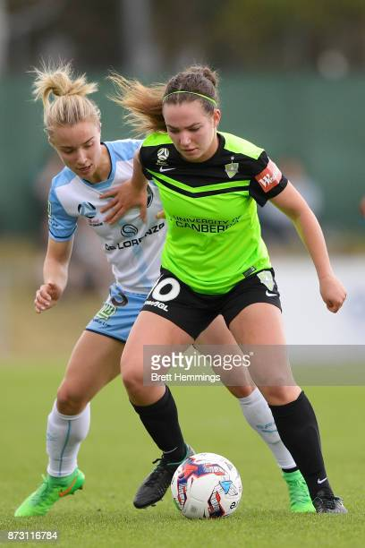 Grace Maher of Canberra is tackled by Georgia YeomanDale of Sydney during the round three WLeague match between Canberra United and Sydney FC at...
