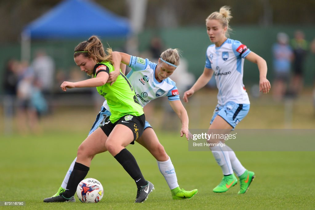 Grace Maher of Canberra is tackled by Kylie Ledbrook of Sydney during the round three W-League match between Canberra United and Sydney FC at McKellar Park on November 12, 2017 in Canberra, Australia.