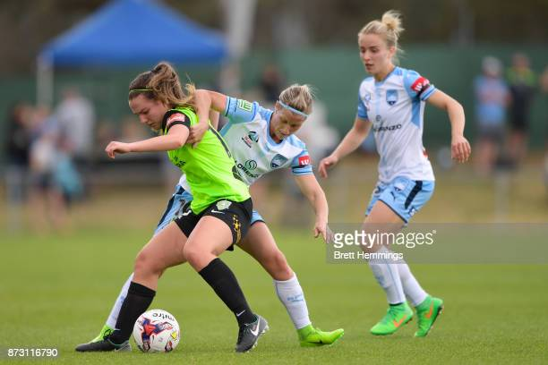 Grace Maher of Canberra is tackled by Kylie Ledbrook of Sydney during the round three WLeague match between Canberra United and Sydney FC at McKellar...