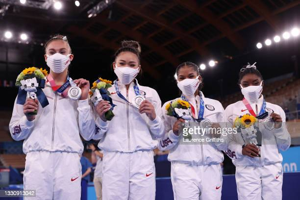 Grace McCallum, Sunisa Lee, Jordan Chiles and Simone Biles of Team United States celebrate after winning the silver medal during the Women's Team...