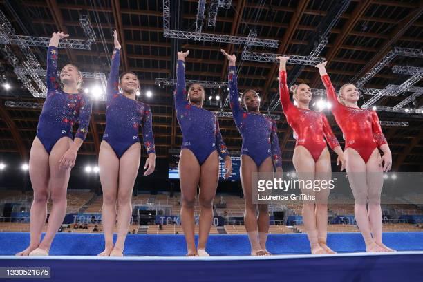 Grace McCullum, Sunisa Lee, Jordan Chiles, Simone Biles, Mykayla Skinner and Jade Carey of Team USA wave as they line up ahead of their floor...