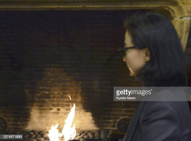 Grace Meng the wife of Meng Hongwei the former Interpol president being investigated in his native China was at her request photographed out of focus...
