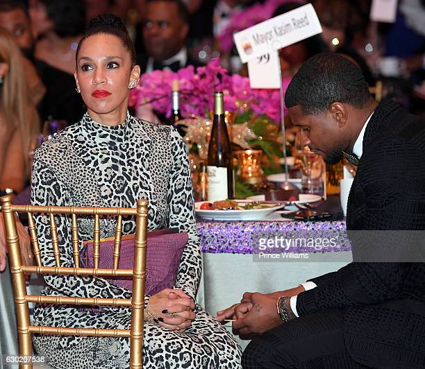 Grace Miguel and Usher Raymond attend the 33rd annual UNCF Mayors Masked Ball at Atlanta Marriott Marquis on December 17, 2016 in Atlanta, Georgia.