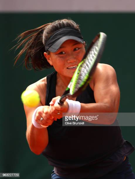 Grace Min of The United States plays a backhand during the ladies singles first round match against Camila Giorgi of Italy during day two of the 2018...