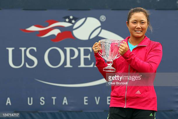 Grace Min of the United States poses with the trophy after defeating Caroline Garcia of France to win the Junior Girls' Singles Final on Day Fourteen...