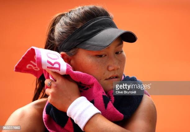 Grace Min of The United States reacts during the ladies singles first round match against Camila Giorgi of Italy during day two of the 2018 French...
