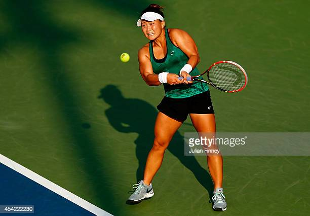 Grace Min of the United States returns a shot against Ekaterina Makarova of Russia during their women's singles first round match on Day Two of the...