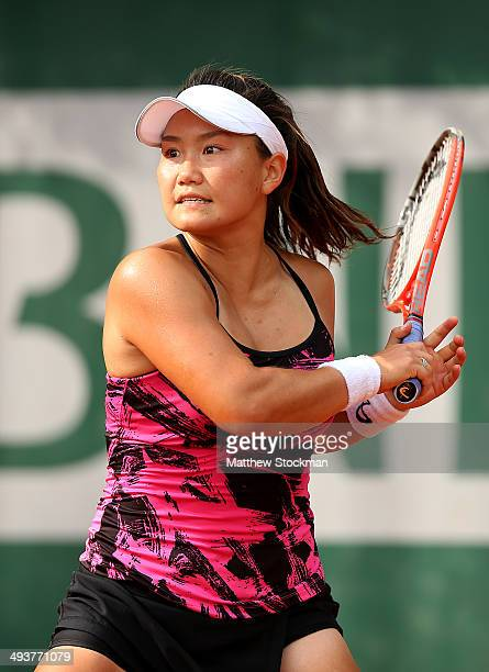 Grace Min of the United States returns a shot during her women's singles match against Garbine Muguruza of Spain on day one of the French Open at...