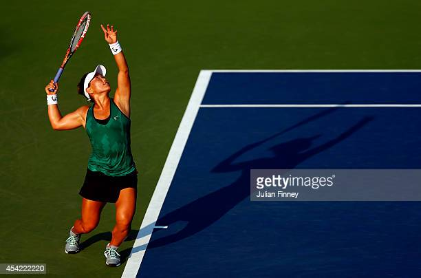 Grace Min of the United States serves against Ekaterina Makarova of Russia during their women's singles first round match on Day Two of the 2014 US...