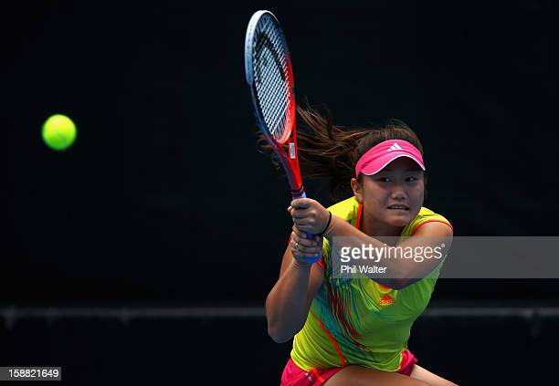 Grace Min of the USA plays a backhand in ther first round match against Maryna Zanevska of the Ukraine during day one of the 2013 ASB Classic on...
