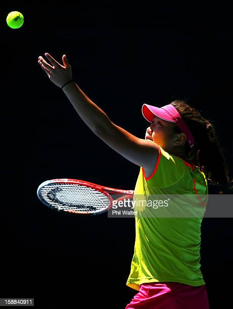 Grace Min of the USA serves in her second round match against Mona Barthel of Germany during day two of the 2013 ASB Classic on January 1 2013 in...