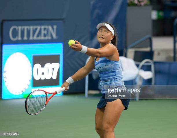 Grace Min of USA serves during qualifying game against Katarzyna Piter of Poland at US Open 2017