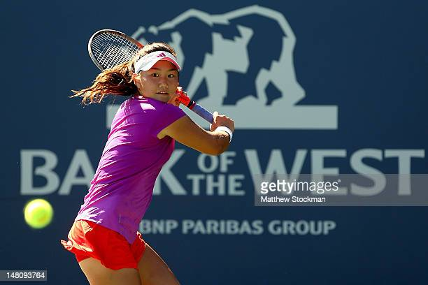 Grace Min returns a shot to Chanelle Scheepers of South Africa during the Bank of the West Classic at Stanford University Taube Family Tennis Stadium...