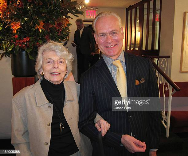 Grace Mirabella former editorinchief of Vogue magazine and TV personality Tim Gunn pose at Michael's Restaurant circa October 2011 in New York City