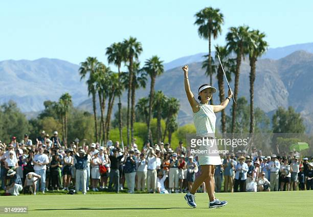 Grace Park celebrates a onestroke victory at the Kraft Nabisco Championship at the Mission Hills Country Club March 28 2004 in Rancho Mirage...