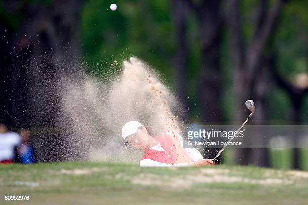 Grace Park of South Korea hits out of a bunker on the 9th hole during the first round of the SemGroup Championship presented by John Q Hammons on May...