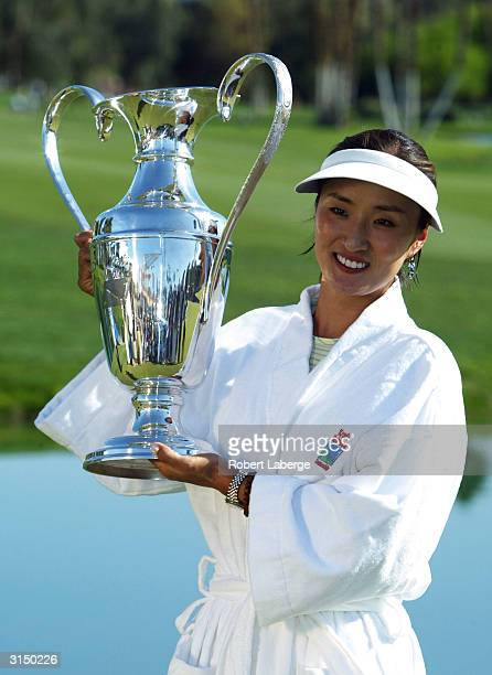Grace Park of South Korea poses with the Dinah Shore Trophy after Park won the Kraft Nabisco Championship on March 28 2004 at the Mission Hills...
