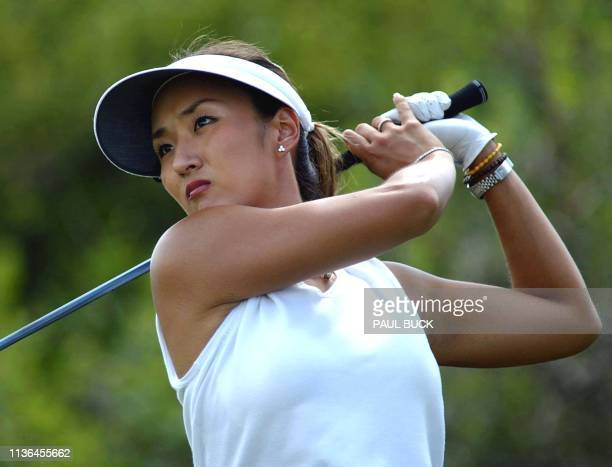 Grace Park of South Korea watches her drive on number six during the opening round of the US Women's Open at Prairie Dunes Country Club in Hutchinson...