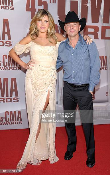 Grace Potter and Kenny Chesney attend the 45th annual CMA Awards at the Bridgestone Arena on November 9 2011 in Nashville Tennessee
