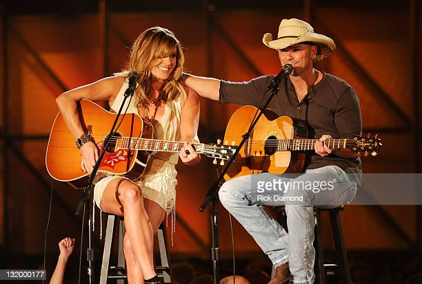 Grace Potter and Kenny Chesney perform at the 45th annual CMA Awards at the Bridgestone Arena on November 9 2011 in Nashville Tennessee
