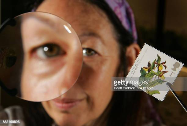 Grace Prendergast Scientist at Kew Gardens in southwest London inspects one of the first class stamps from the Royal Mail's new endangered plants...