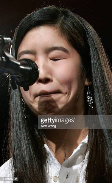 Grace Pyo of Birmingham Alabama reacts after she misspelled the word difficile during the 2007 Scripps National Spelling Bee May 31 2007 in...