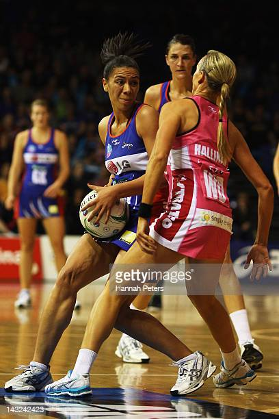 Grace Rasmussen of the Mystics looks to get the ball past Emily Beaton of the Thunderbirds during the round four ANZ Championship match between the...