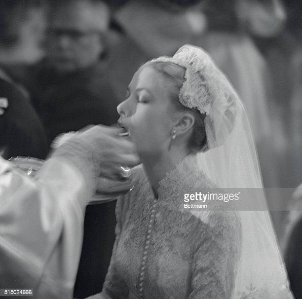 Grace Receives Holy Communion Grace Kelly receives Holy Communion during colorful religious ceremony today in the cathedral at Monaco in which she...