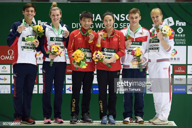 Grace Reid and Thomas Daley of Great Britain Han Wang and Zheng Li of China Nadezhda Bazhina and Nikita Shleikher of Russia pose on the podium after...