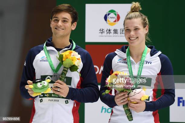 Grace Reid and Thomas Daley of Great Britain smile on the podium after the Mixed 3m Synchro Springboard final during day three of the FINA Diving...