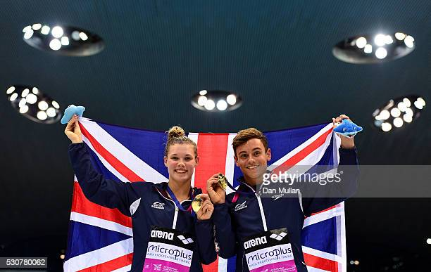 Grace Reid and Tom Daley of Great Britain pose with their gold medals following victory in the Diving Mixed 3m Synchronised Final on day three of the...